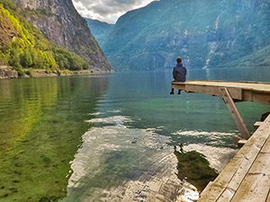 Pipeaway blogger sitting on the pier on Vassbygdevatnet Lake in Aurland, Norway, photo by Ivan Kralj
