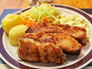 Codfish with potatoes and apple and carrot salad served in Bjellands Kjokken in Bergen, Norway, the rainiest city in Europe, photo by Ivan Kralj