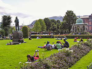 People resting on the grass at Byparken in Bergen, Norway, the wettest place in Europe, photo by Ivan Kralj