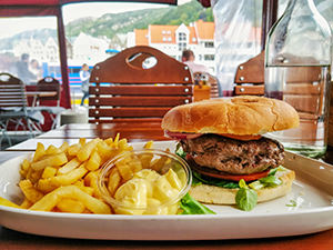 Whale burger with French fries at Fish Me restaurant in Bergen, Norway, photo by Ivan Kralj