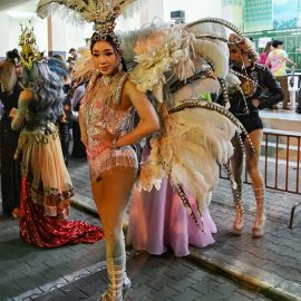 Participant dressed in feathers posing at Chiang Mai Pride, gay parade in Chiang Mai, Thailand, photo by Ivan Kralj