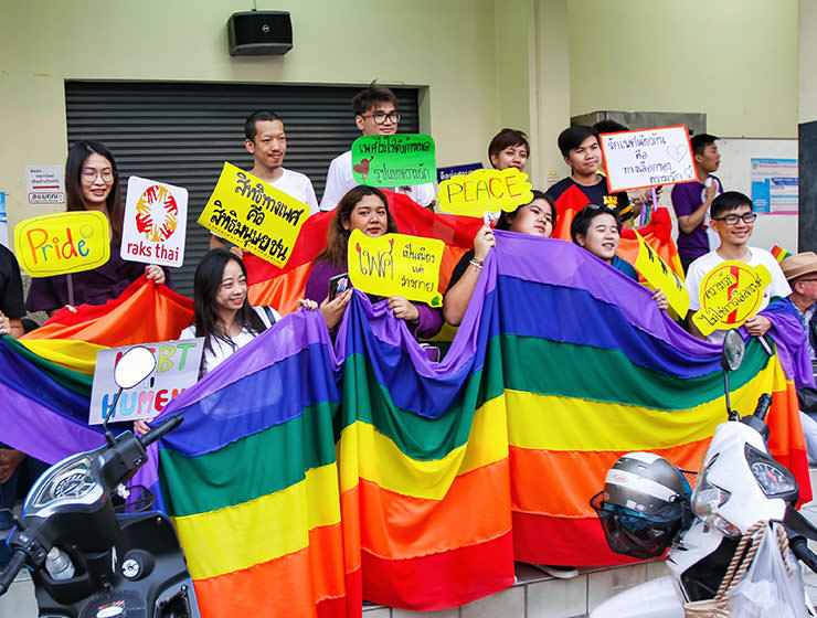 Participants posing with big rainbow flag at Chiang Mai Pride, gay parade in Chiang Mai, Thailand, photo by Ivan Kralj