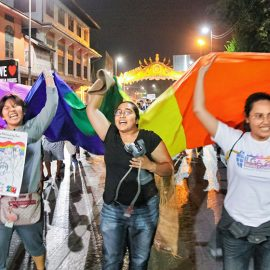Participants shouting while walking with a huge rainbow flag at Chiang Mai Pride, gay parade in Chiang Mai, Thailand, photo by Ivan Kralj