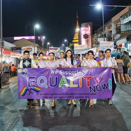 "Participants with placard ""we support equality"" walking at Chiang Mai Pride, gay parade in Chiang Mai, Thailand, photo by Ivan Kralj"