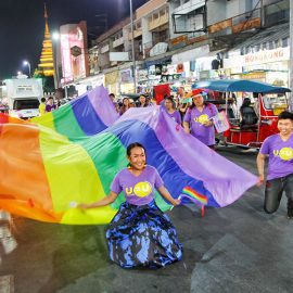 Participants with a huge rainbow flag at Chiang Mai Pride, gay parade in Chiang Mai, Thailand, photo by Ivan Kralj