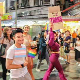 "Participants with placard ""proud to be trans"" walking at Chiang Mai Pride, gay parade in Chiang Mai, Thailand, photo by Ivan Kralj"
