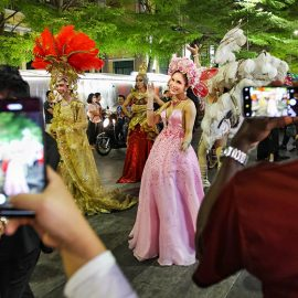 Passers-by photographing the ladyboy participants at Chiang Mai Pride, gay parade in Chiang Mai, Thailand, photo by Ivan Kralj
