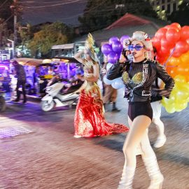 Lady Gaga impersonator with a telephone, crossing the road at Chiang Mai Pride, gay parade in Chiang Mai, Thailand, photo by Ivan Kralj
