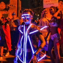 Participant in lighted costume posing at Chiang Mai Pride, gay parade in Chiang Mai, Thailand, photo by Ivan Kralj