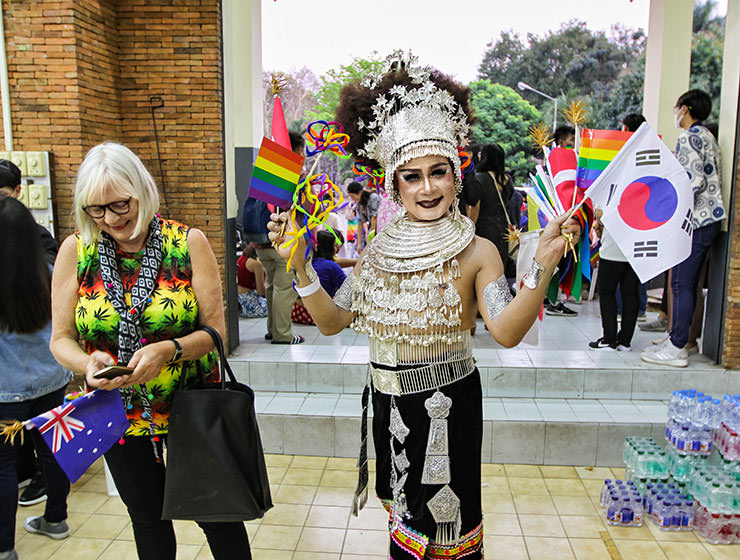 Participant in silver outfit posing at Chiang Mai Pride, gay parade in Chiang Mai, Thailand, photo by Ivan Kralj
