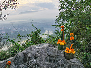 Buddhist offering in the foreground of a view from the Phou Si Mountain top, supposedly one of the best places to watch sunrise and sunset in Luang Prabang, Laos, photo by Ivan Kralj