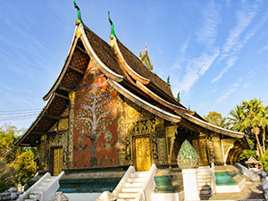 The tree of life painted on the back wall of Wat Xieng Thong's sim; visiting this temple is considered to be one of the best things to do in Luang Prabang, photo by Ivan Kralj