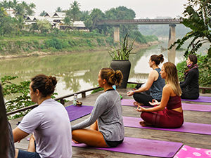 Yoga practitioners at Utopia on the banks of Nam Khan River, one of the best things to do in Luang Prabang, Laos, photo by Ivan Kralj
