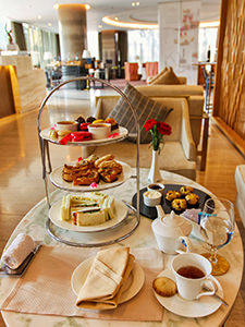 Three-tiered afternoon tea set with savoury and sweet delights in the Elephant Lounge of Crowne Plaza Vientiane, 5 star hotel in Laos capital, photo by Ivan Kralj
