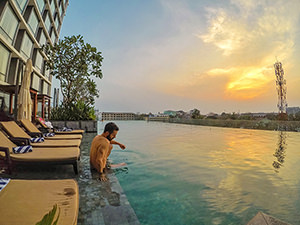 Swimming pool at Crowne Plaza Vientiane, 5 star hotel in Laos capital, during sunset, photo by Ivan Kralj