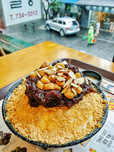 Injeolmi Bingsu, an ice-flakes bowl topped with Injeolmi, a rice cake with soybean powder, azuki beans and sliced almonds, one of the best Korean desserts to try in Seoul, as served in Sulbing Insadong, Seoul, South Korea, photo by Ivana Kralj