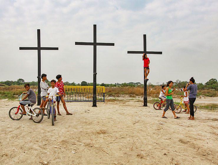 Children posing next to the crosses that will be a central point of the crucifiction in Pampanga, San Fernando, San Pedro Cutud, during Maleldo 2019, the Holy Week Philippines, photo by Ivan Kralj