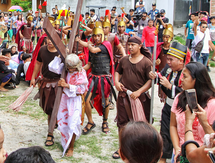 Wilfredo Salvador (62) carrying a wooden cross before going through the crucifixion in Pampanga, San Fernando, the baray of San Juan, which is one of the highlights of the Maleldo 2019, Holy Week Philippines, photo by Ivan Kralj