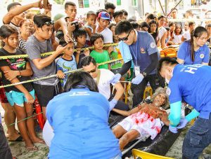 Wilfredo Salvador (62) being treated by the medical team after the crucifixion in Pampanga, San Fernando, the baray of San Juan, which is one of the highlights of the Maleldo 2019, Holy Week Philippines, photo by Ivan Kralj