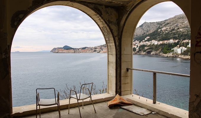 Terrace with broken chairs at Hotel Belvedere Dubrovnik, one of the abandoned hotels left to decay, photo by Ivan Kralj