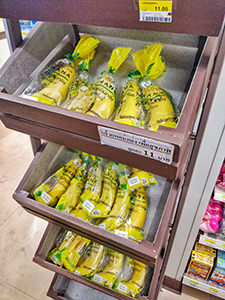 Bananas displayed in 7/11 store on Koh Samet island in Thailand, with each banana wrapped in its own plastic bag, photo by Ivan Kralj