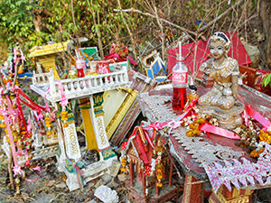 Spirit houses on Koh Samet island in Thailand; drinks offered to the spirits have plastic straws, photo by Ivan Kralj