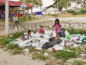 Children playing on the piles of trash on Koh Samet, so-called plastic-free island and a national park in Thailand, photo by Ivan Kralj