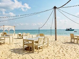 Beach restaurant at Mooban Talay Resort, tables set in the sand of Ao Noi Na beach, Koh Samet island, Thailand, photo by Ivan Kralj