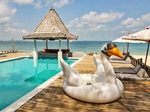 Swan floatie next to the Mooban Talay Resort swimming pool, at beachfront Mooban Talay Resort, on Koh Samed island, Thailand, photo by Ivan Kralj