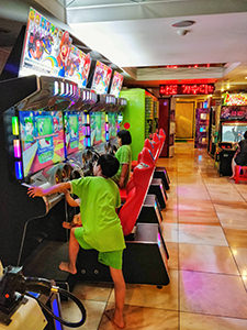 Children playing in the arcade with games in Dragon Hill Spa, a Korean spa / jjimjilbang in Seoul, South Korea, photo by Ivan Kralj