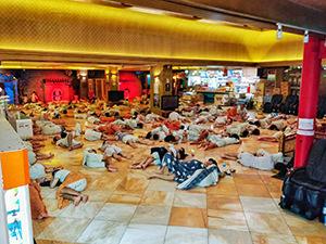 Visitors sleeping on the floor of the main area of Dragon Hill Spa. a Korean spa / jjimjilbang in Seoul, South Korea, photo by Ivan Kralj