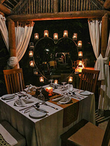 Dinner set with candles forming the shape of heart under the gazebo in Munduku Moding Plantation, nature resort in Bali, Indonesia, photo by Ivan Kralj
