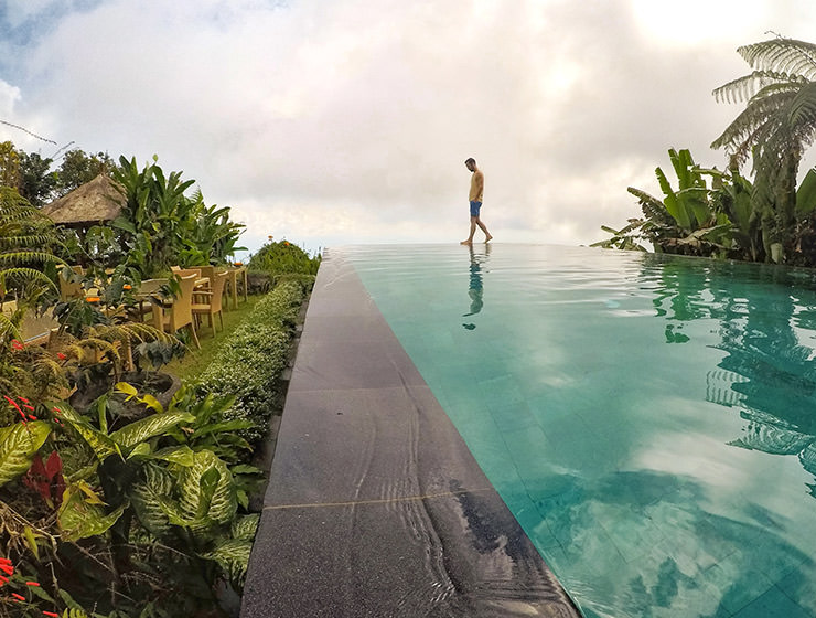 Pipeaway blogger Ivan Kralj walking on the edge of the infinity pool at Munduk Moding Plantation, the only resort set on the working coffee plantation in Bali, Indonesia, photo by Ivan Kralj