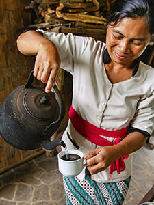 Kadek, one of the farmers on Munduk Moding Plantation, pours coffee into a cup for the visitor of the resort, Bali, Indonesia, photo by Ivan Kralj
