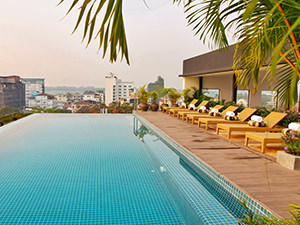 Swimming in the rooftop infinity pool at Lao Poet Hotel is one of the best things to do in Vientiane, Laos, photo by Ivan Kralj