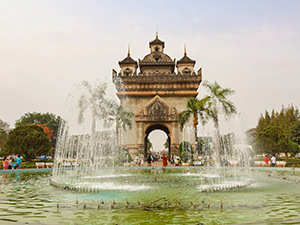 Patuxai victory arch behind the fountain, one of the top places to visit in Vientiane, Laos, photo by Ivan Kralj