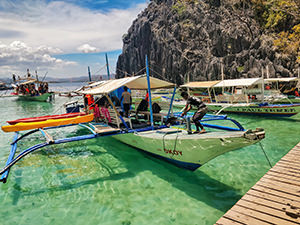 Okoy bangka by JY Travel and Tours parked on a docking place at Barracuda Lake, Coron Palawan, Philippines, photo by Ivan Kralj