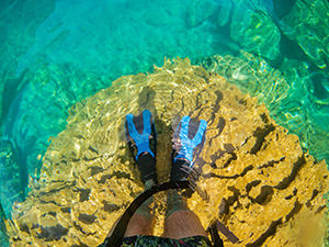 Standing in fins in the shallow waters of Barracuda Lake, Coron Island, Palawan, Philippines, photo by Ivan Kralj