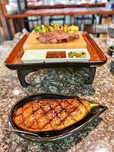 Nasu Dengaku, grilled eggplant glazed with miso, served in front of the Hakata Wagyu Steak, in Tengoku, must-visit Japanese restaurant in Chiang Mai, Thailand, photo by Ivan Kralj