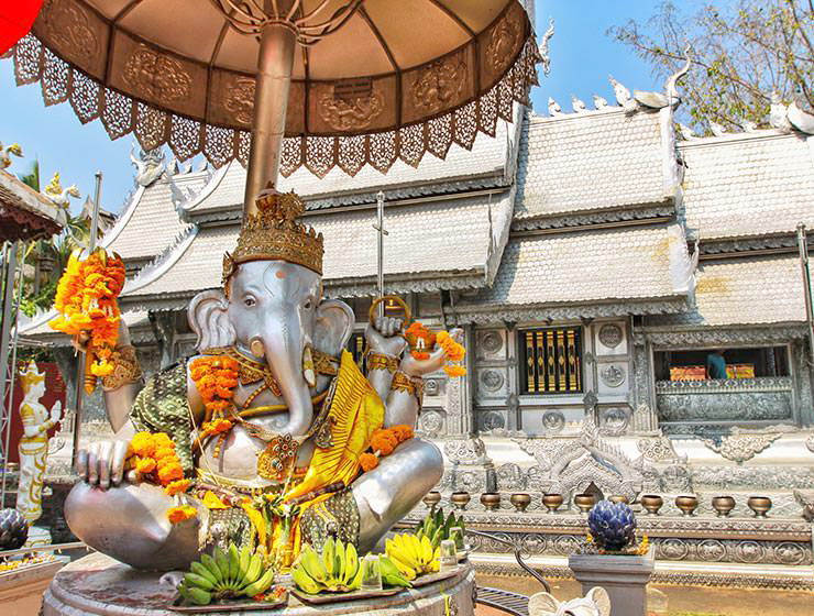 Wat Sri Suphan is better known as Chiang Mai's Silver Temple. Its decoration was made in silversmith workshop, such as this elephant deity, donated with bananas and flowers offerings. Chiang Mai, Thailand. Photo by Ivan Kralj