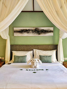 Welcome message and elephant-shaped towel on the bed in the villa at The Amala Estate, one of the best hotels in Bali, Indonesia, photo by Ivan Kralj