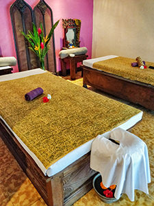 Wide massage beds at Tugu Bali spa, former storage chests for rice, photo by Ivan Kralj