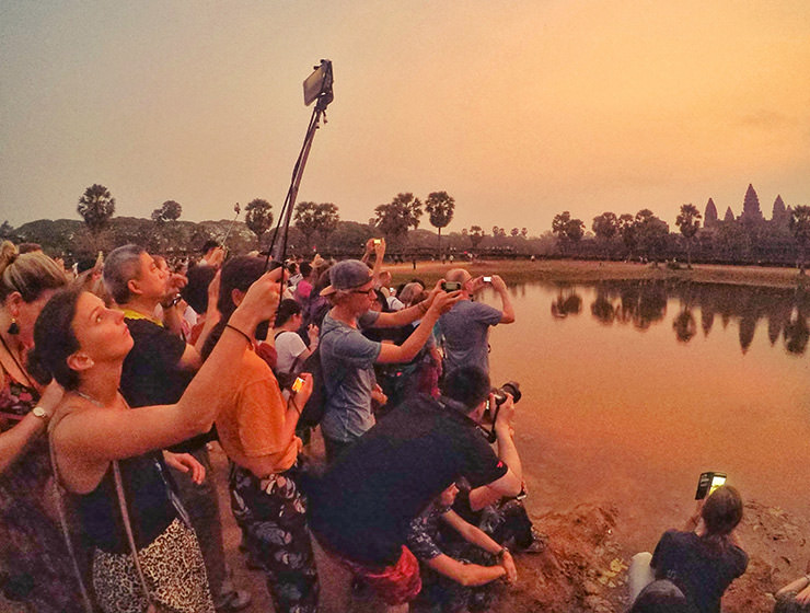 Angkor Wat sunrise draws many visitors to the most famous Cambodian temple, they gather early with all their photo equipment on the crowded reflection pond, photo by Ivan Kralj